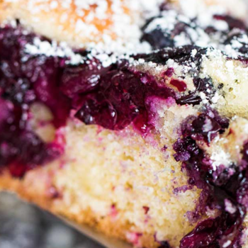 A slice of a blueberry pancake-cake.
